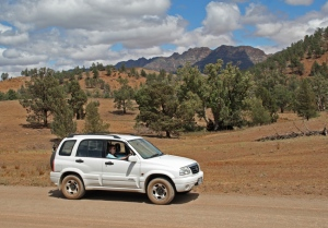 b Driving along the trail with the Elder Ranges in the background