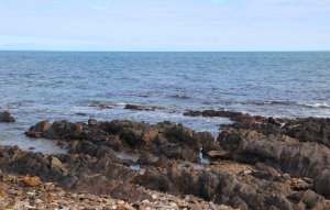 Rocky outcrops extending into the sea