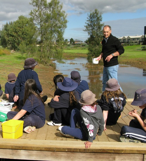 Baz teaching creek studies on the bridge
