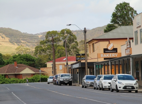 Yankalilla's main street with bakery and surrounding hills visible